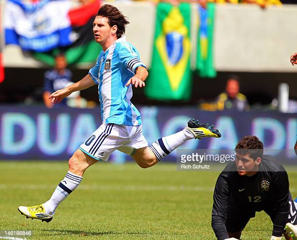 Lionel Messi of Argentina reacts after scoring his second of three goals in an international friendly soccer match on June 9 2012 at MetLife Stadium...