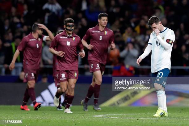 Lionel Messi of Argentina reacts after Venezuela score their third goal of the match during the International Friendly match between Argentina and...