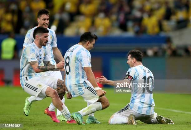 Lionel Messi of Argentina reacts as his team wins the Final of Copa America with teammates Marcos Acuna ,Rodrigo De Paul and Nicolas Tagliafico...