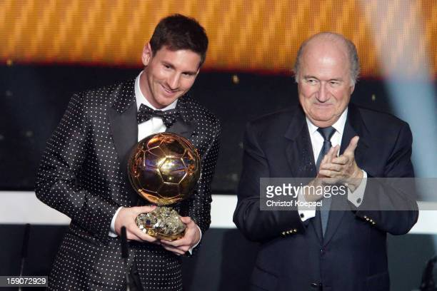 Lionel Messi of Argentina receives the FIFA Ballon d'Or 2012 trophy of Joseph Blatter FIFA president on January 7 2013 in Zurich Switzerland