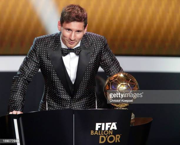 Lionel Messi of Argentina receives the FIFA Ballon d'Or 2012 trophy on January 7 2013 in Zurich Switzerland