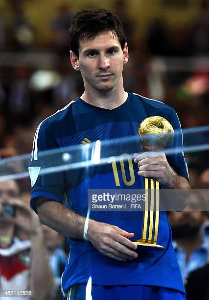 Lionel Messi of Argentina receives the Golden Ball trophy during the award ceremony after the 2014 FIFA World Cup Brazil Final match between Germany...