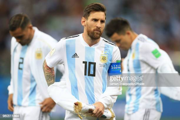 Lionel Messi of Argentina removes his jacket during the 2018 FIFA World Cup Russia Group D match between Argentina and Croatia at the Nizhny Novgorod...