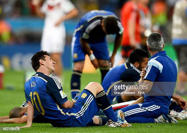Lionel Messi of Argentina rests on the pitch before the extra time during the 2014 FIFA World Cup Brazil Final match between Germany and Argentina at...