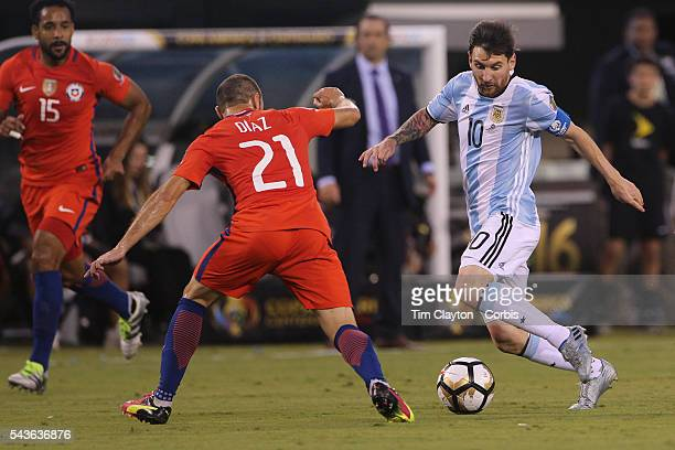Lionel Messi of Argentina runs at Marcelo Diaz of Chile during the Argentina Vs Chile Final match of the Copa America Centenario USA 2016 Tournament...