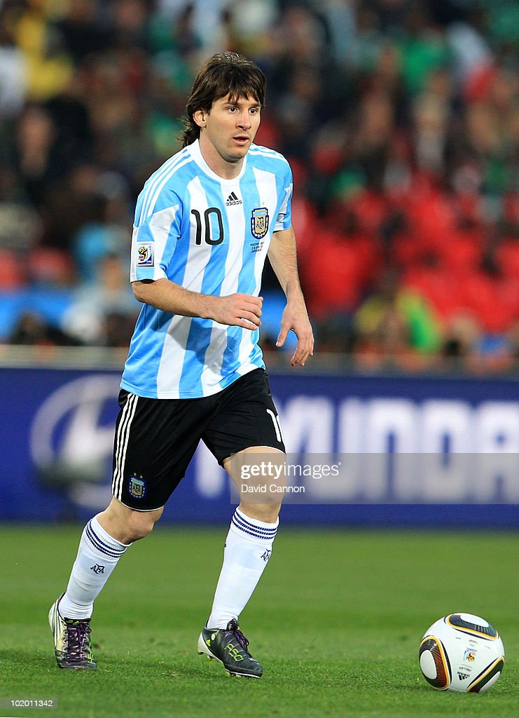 Lionel Messi of Argentina runs with the ball during the 2010 FIFA World Cup South Africa Group B match between Argentina and Nigeria at Ellis Park Stadium on June 12, 2010 in Johannesburg, South Africa.