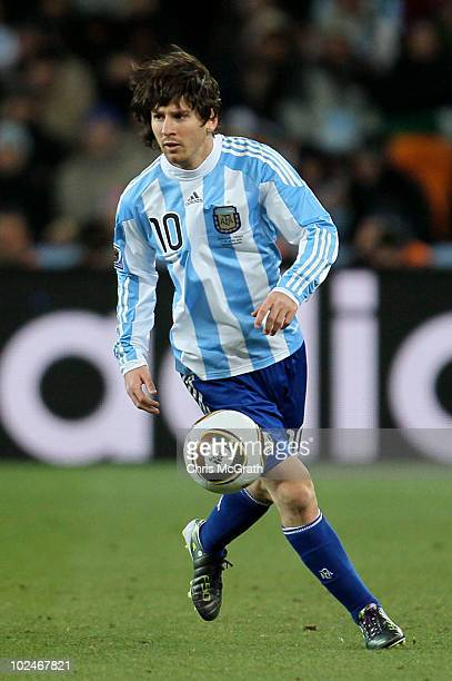 Lionel Messi of Argentina runs with the ball during the 2010 FIFA World Cup South Africa Round of Sixteen match between Argentina and Mexico at...