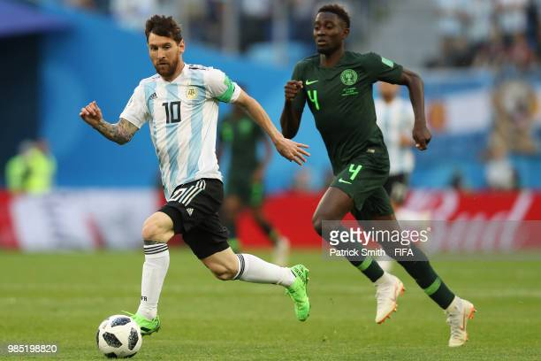 Lionel Messi of Argentina runs with the ball during the 2018 FIFA World Cup Russia group D match between Nigeria and Argentina at Saint Petersburg...
