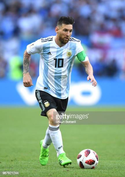 Lionel Messi of Argentina runs with the ball during the 2018 FIFA World Cup Russia Round of 16 match between France and Argentina at Kazan Arena on...