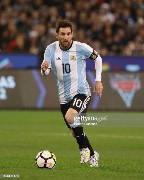 Lionel Messi of Argentina runs with the ball during the Brazil Global Tour match between Brazil and Argentina at Melbourne Cricket Ground on June 9...