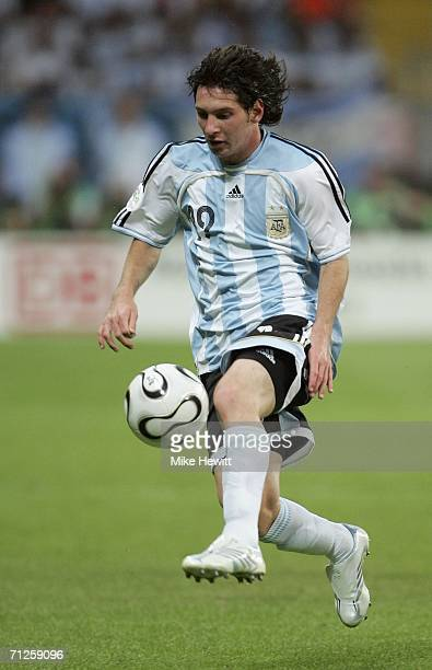 Lionel Messi of Argentina runs with the ball during the FIFA World Cup Germany 2006 Group C match between Netherlands and Argentina at the Stadium...