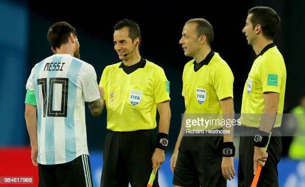 Lionel Messi of Argentina sahkes hands with linesmen Bahattin Duran Tarik Ongun and Referee Cuneyt Cakir during the 2018 FIFA World Cup Russia group...