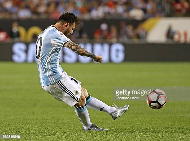 Lionel Messi of Argentina scores a goal on a penalty kick against Panama during a match in the 2016 Copa America Centenario at Soldier Field on June...