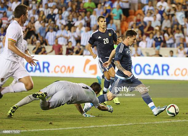Lionel Messi of Argentina scores a goal past Dainel Vaca of Bolivia during their international friendly match at BBVA Compass Stadium on September 4...