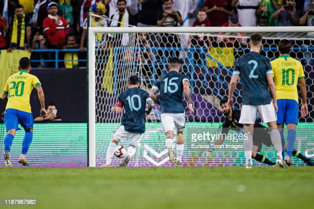 Lionel Messi of Argentina scores his goal during the international friendly match between Brazil and Argentina at the King Saud University Stadium on...