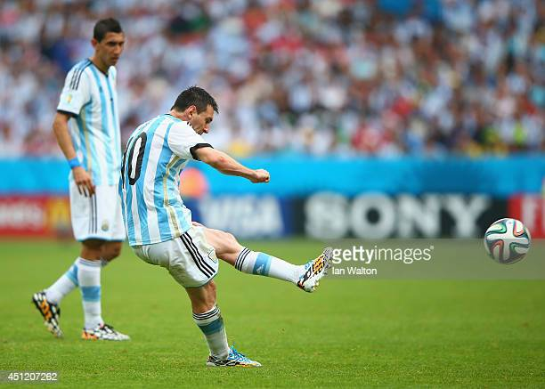 Lionel Messi of Argentina scores his team's second goal and his second of the game on a free kick during the 2014 FIFA World Cup Brazil Group F match...