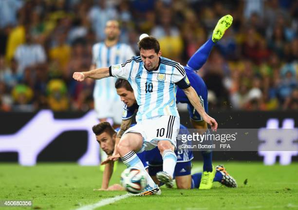 Lionel Messi of Argentina scores the team's second goal during the 2014 FIFA World Cup Brazil Group F match between Argentina and BosniaHerzegovina...