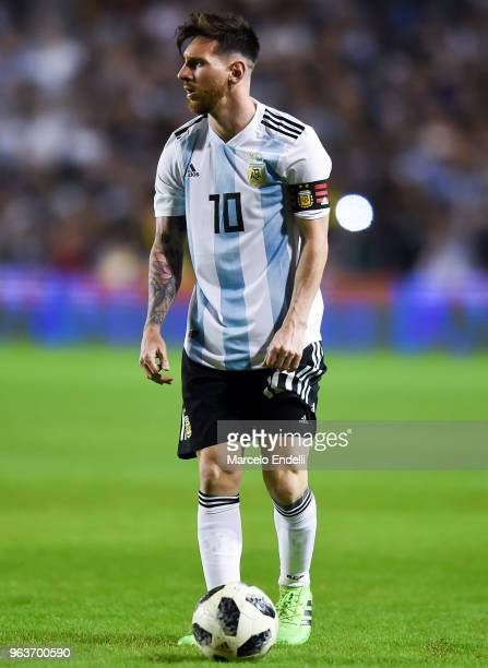 Lionel Messi of Argentina sets up for a free kick during an international friendly match between Argentina and Haiti at Alberto J Armando Stadium on...