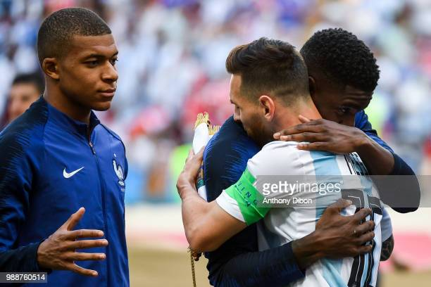 Lionel Messi of Argentina shakes hand with Kylian Mbappe and Samuel Umtiti of France during the FIFA World Cup Round of 16 match between France and...