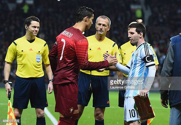 Lionel Messi of Argentina shakes hands with Cristiano Ronaldo of Portugal prior to the International Friendly match between Argentina and Portugal at...