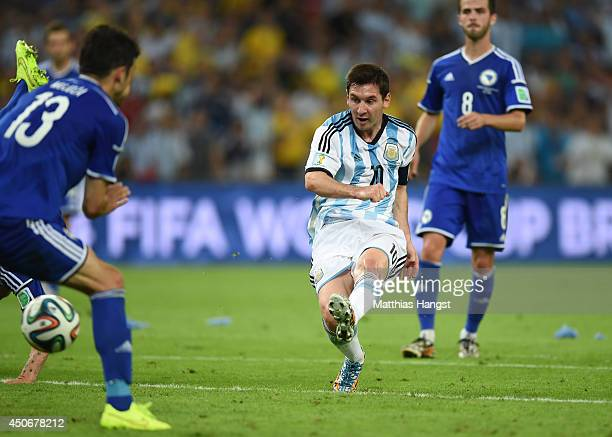 Lionel Messi of Argentina shoots and scores his team's second goal during the 2014 FIFA World Cup Brazil Group F match between Argentina and...