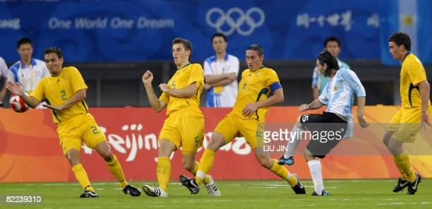 Lionel Messi of Argentina shoots the ball as Australia's players Stuart Musialik Mark Milligan Mathew Spiranovic and Jade North defend during a 2008...