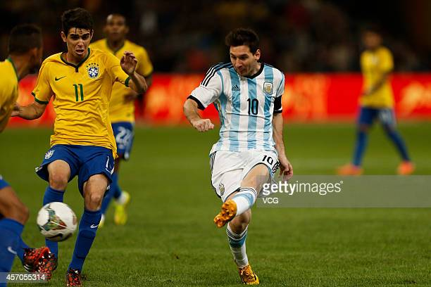 Lionel Messi of Argentina shoots the ball during a match between Argentina and Brazil as part of 2014 Super Clasico at Beijing National Stadium on...