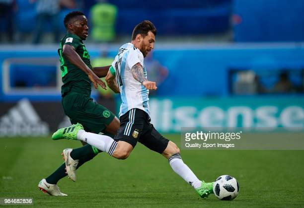 Lionel Messi of Argentina shoots to goal front of Kenneth Omeruo of Nigeria during the 2018 FIFA World Cup Russia group D match between Nigeria and...