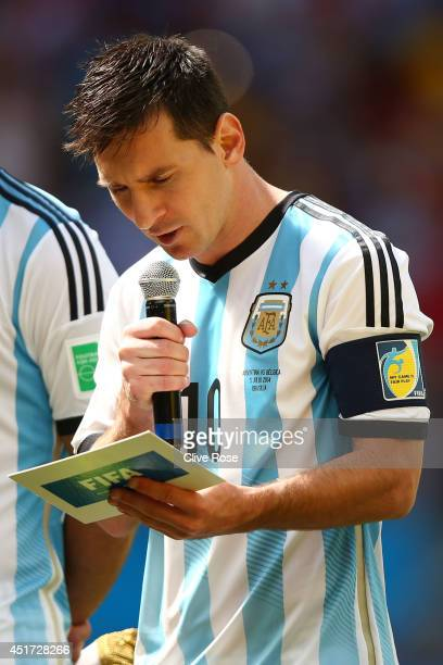 Lionel Messi of Argentina speaks prior to the 2014 FIFA World Cup Brazil Quarter Final match between Argentina and Belgium at Estadio Nacional on...
