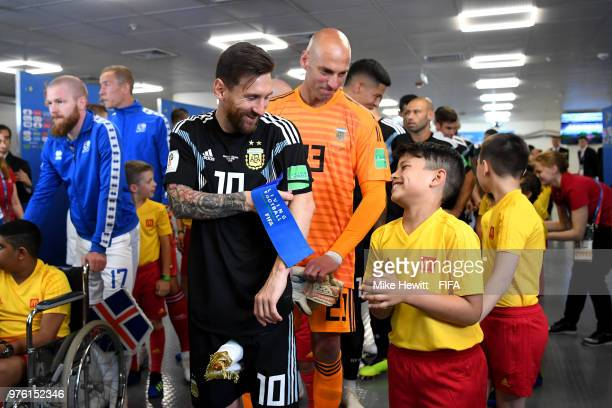 Lionel Messi of Argentina speaks with a mascot in the tunnel prior to the 2018 FIFA World Cup Russia group D match between Argentina and Iceland at...