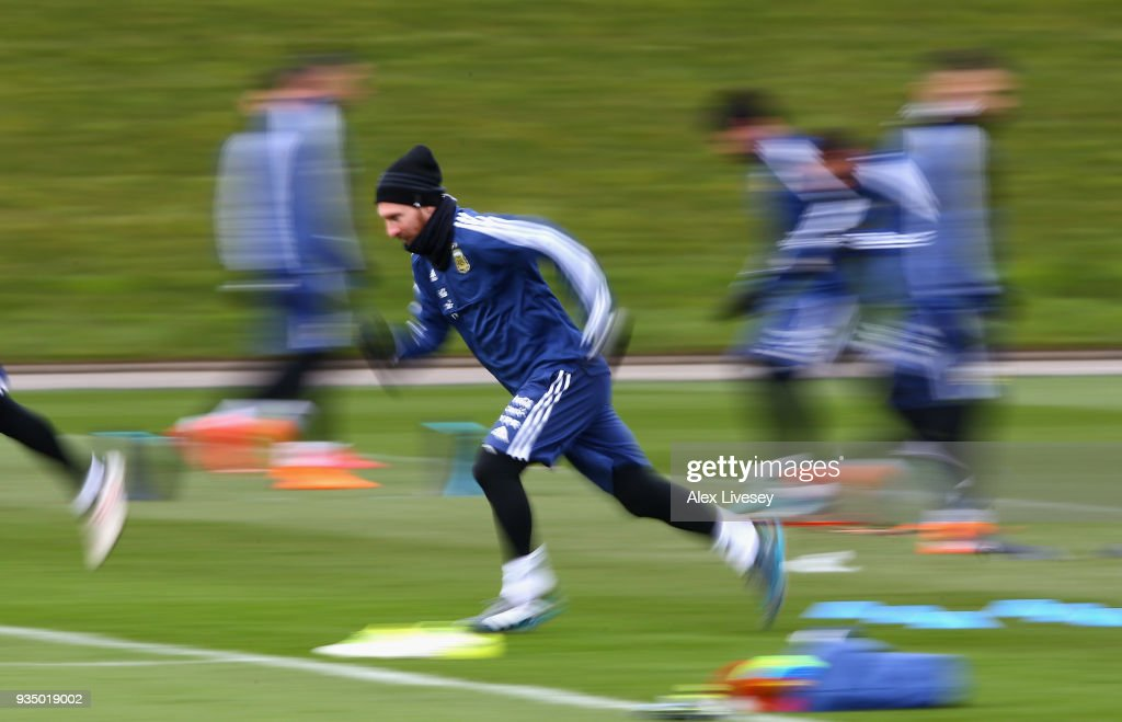 Lionel Messi of Argentina sprints during a Argentina training session at Manchester City Football Academy on March 20, 2018 in Manchester, England.