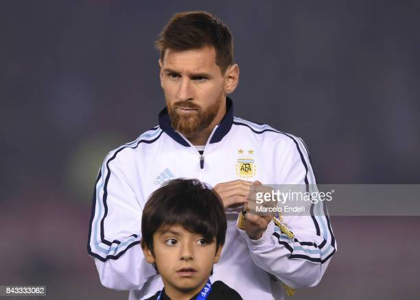 Lionel Messi of Argentina stands next to Benjamin Aguero Maradona during the national anthem ceremony ahead of match between Argentina and Venezuela...
