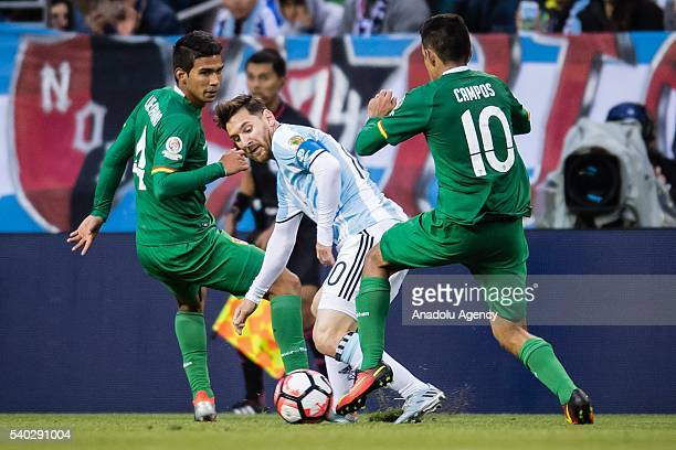 Lionel Messi of Argentina struggles for the ball against Jhasmany Campos of Bolivia during the 2016 Copa America Centenario Group D match between...