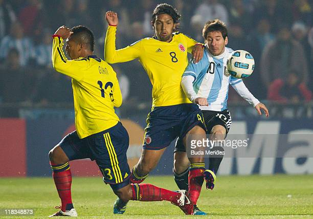 Lionel Messi of Argentina struggles for the ball with Fredy Guarin and Abel Aguilar of Colombia during a match as part of Group A of Copa America...