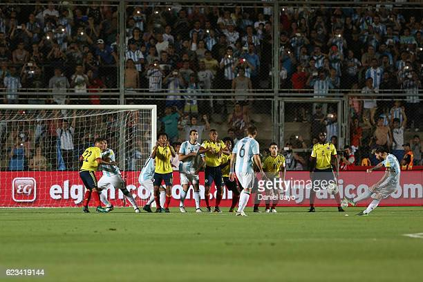 Lionel Messi of Argentina takes a free kick to score the opening goal during a match between Argentina and Colombia as part of FIFA 2018 World Cup...