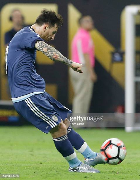 Lionel Messi of Argentina takes a free kick to score the second goal of his team during the Semifinal match between United States and Argentina at...
