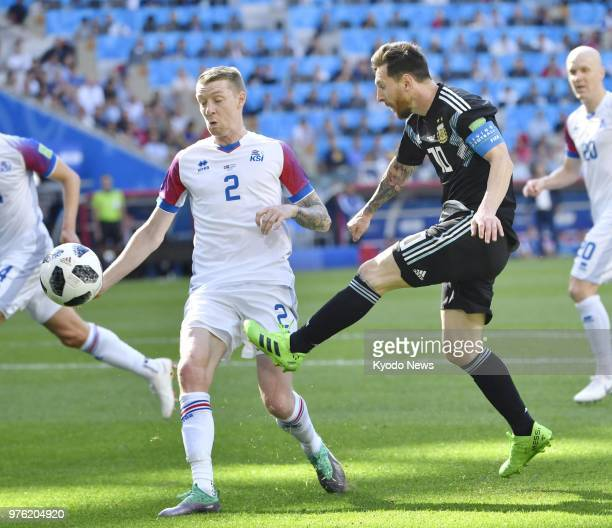 Lionel Messi of Argentina takes a shot past Birkir Saevarsson of Iceland during the first half of a football World Cup group stage match at Spartak...