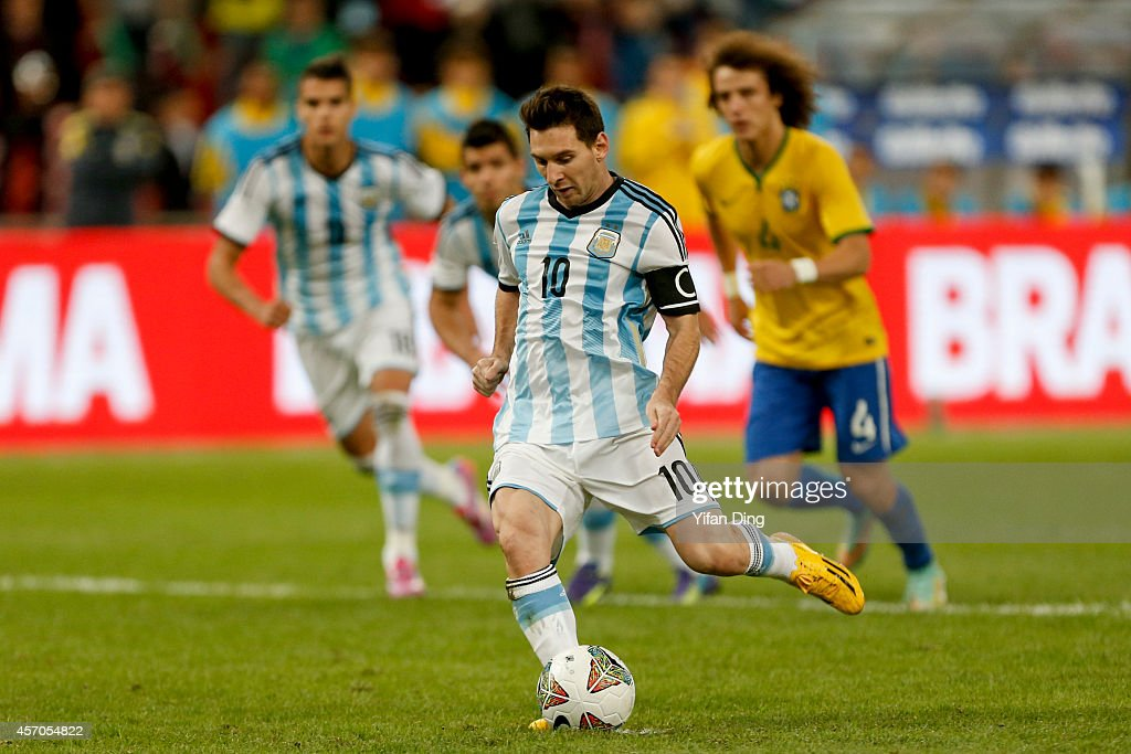 Lionel Messi #10 of Argentina takes and misses a penalty kick during a match between Argentina and Brazil as part of 2014 Superclasico de las Americas at Bird Nest Stadium on October 11, 2014 in Beijing, China.