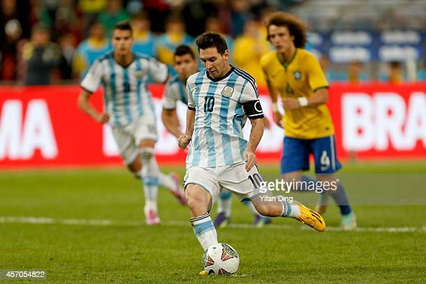 Lionel Messi of Argentina takes and misses a penalty kick during a match between Argentina and Brazil as part of 2014 Superclasico de las Americas at...