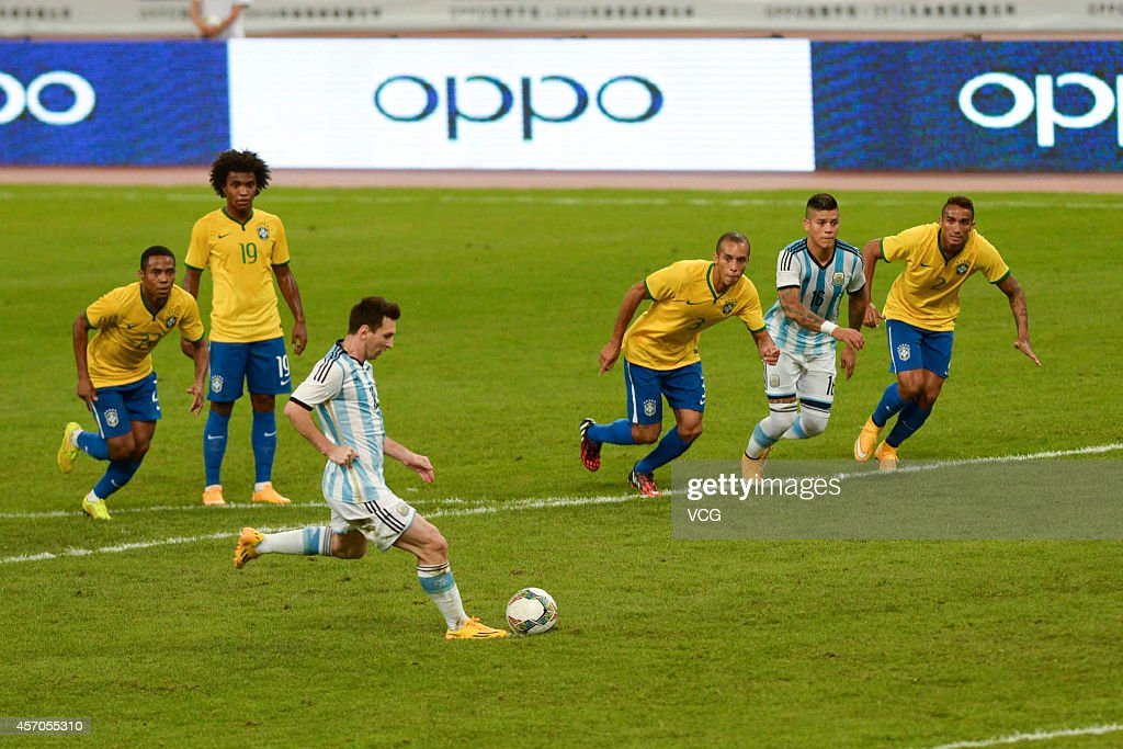 Lionel Messi #10 of Argentina takes and misses a penalty kick during a match between Argentina and Brazil as part of 2014 Super Clasico at Beijing National Stadium on October 11, 2014 in Beijing, China.