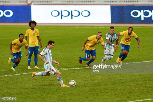 Lionel Messi of Argentina takes and misses a penalty kick during a match between Argentina and Brazil as part of 2014 Super Clasico at Beijing...