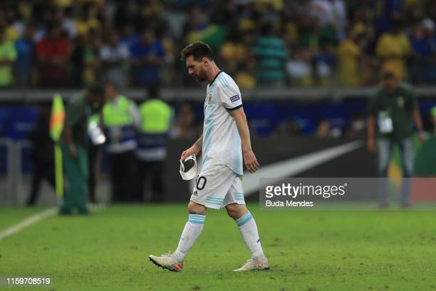 Lionel Messi of Argentina takes off his captain armband during the Copa America Brazil 2019 Semi Final match between Brazil and Argentina at Mineirao...