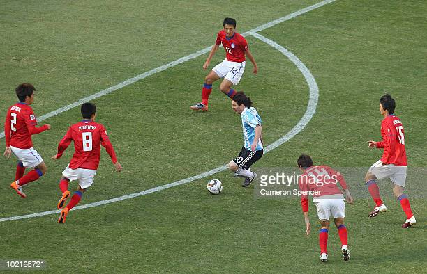 Lionel Messi of Argentina takes on the South Korea defence during the 2010 FIFA World Cup South Africa Group B match between Argentina and South...