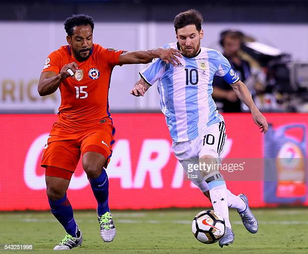 Lionel Messi of Argentina takes the ball as Jean Beausejour of Chile defends during the Copa America Centenario Championship match at MetLife Stadium...