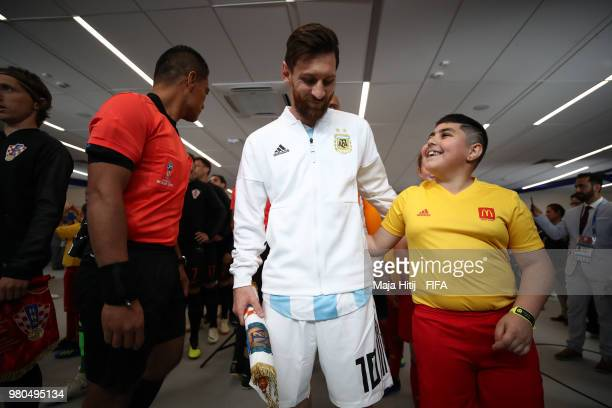 Lionel Messi of Argentina talks to a mascot prior to the 2018 FIFA World Cup Russia group D match between Argentina and Croatia at Nizhny...