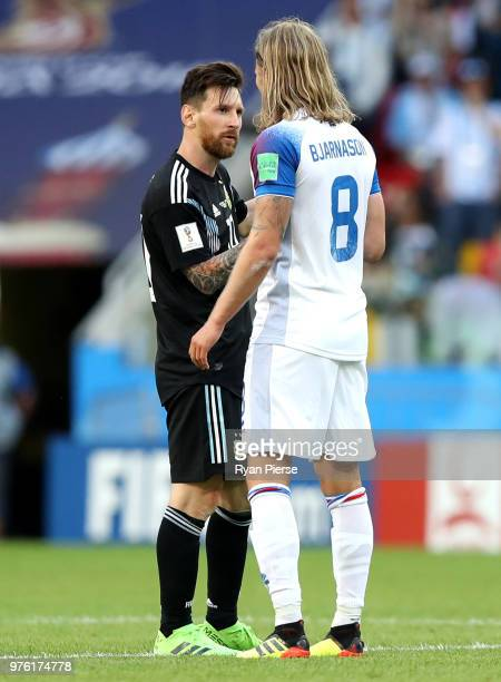 Lionel Messi of Argentina talks to Birkir Bjarnason of Iceland during the 2018 FIFA World Cup Russia group D match between Argentina and Iceland at...