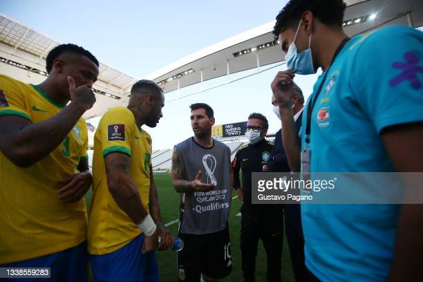 Lionel Messi of Argentina talks to Neymar Jr. Of Brazil after the match between Brazil and Argentina was interrupted by Brazilian health authorities...