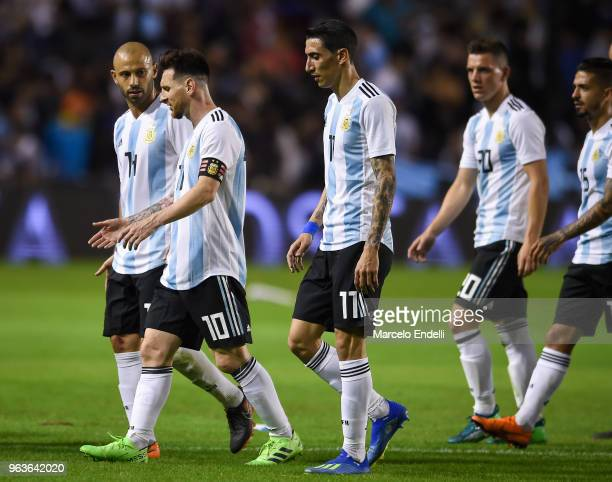 Lionel Messi of Argentina talks to teammate Javier Mascherano at halftime during an international friendly match between Argentina and Haiti at...