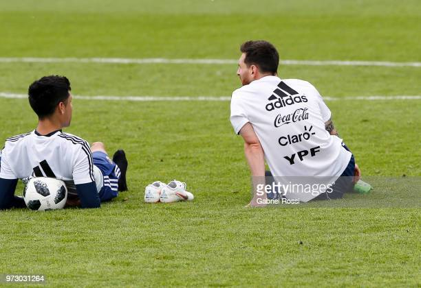 Lionel Messi of Argentina talks with Enzo Perez of Argentina during a training session at the team base camp on June 13 2018 in Bronnitsy Russia