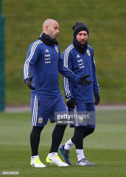 Lionel Messi of Argentina talks with Javier Mascherano during a Argentina training session at Manchester City Football Academy on March 20 2018 in...